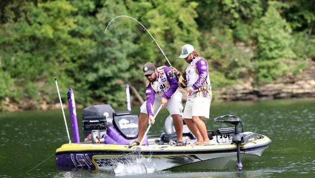 LSUS anglers J.P. Kimbrough and Jared Rascoe work to bring in a fish during Saturday's Carhartt Bassmaster College Series National Championship on Kentucky's Green River Lake.