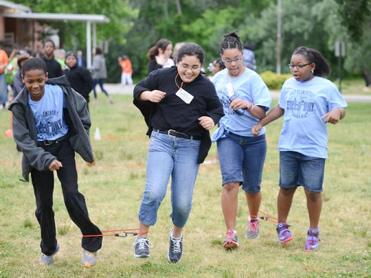 Children participate in a relay race Thursday at East Elementary School during field day.