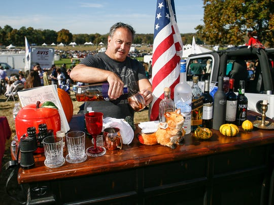 Steve Lanagan of Monmouth Beach pours a refreshment at his bar during the 96th running of the Far Hills Race Meeting on October 15, 2016.