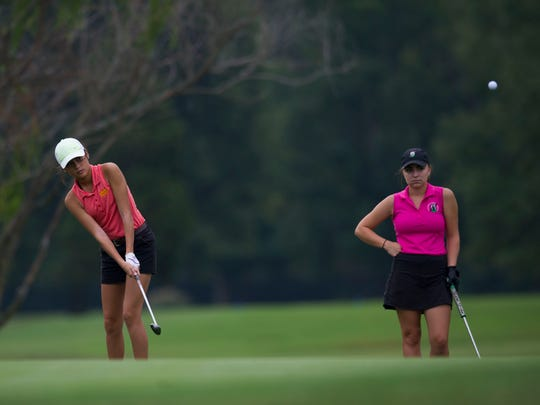 Mater Dei's Hannah Julow hits a shot as North's Brittany Skinner watches during the SIAC girl's high school tournament at McDonald Golf Course on Saturday morning.