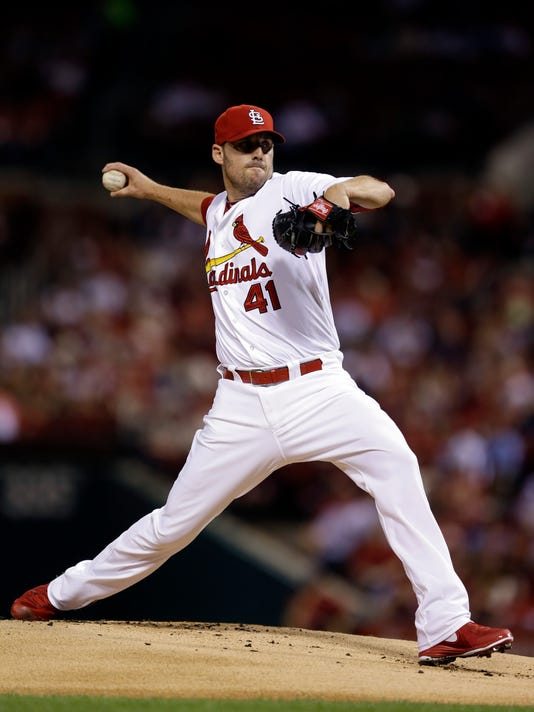 St. Louis Cardinals starting pitcher John Lackey throws during the first inning of a baseball game against the Cincinnati Reds, Friday, Sept. 19, 2014, in St. Louis. (AP Photo/Jeff Roberson)