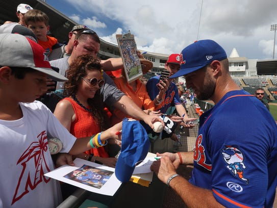 Tim Tebow, of the St. Lucie Mets, signs autographs