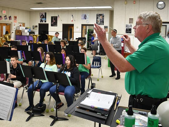 Mark Cartwright conducts the band students at Barwise