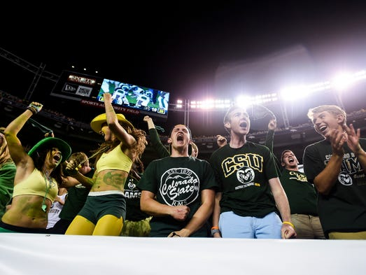 Fans celebrate CSU's first touchdown of the Rocky Mountain Showdown against CU on Friday, August 29, 2014 at Sports Authority Field at Mile High.