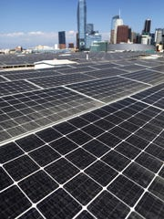 Solar panels are mounted atop the roof of the Los Angeles Convention Center on September 5, 2018 in Los Angeles, California. The solar array of 6,228 panels is expected to generate 3.4 million kilowatt hours of electricity per year.