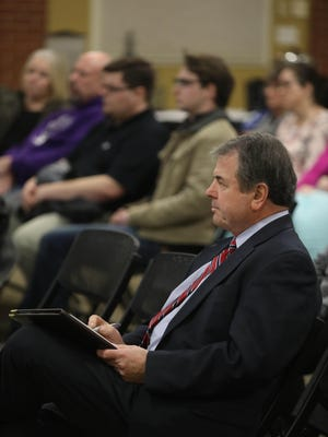 "Southeastern Community College President Michael Ash takes notes Jan. 9, 2019, during a ""Town Hall"" meeting hosted by Iowa Wesleyan University in the Social Hall of the Howe Student Activity Center on campus in Mount Pleasant. Iowa Wesleyan University and SCC have announced a memorandum of understanding to explore the development of a strategic partnership between institutions."