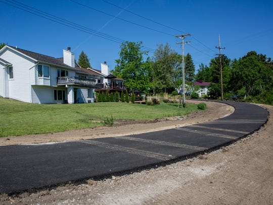 A bicycle path winds behind homes on the east side of Water Street as pictured Friday, June 3, 2016 in Port Huron Township. The path is expected to be completed by the end of the month.