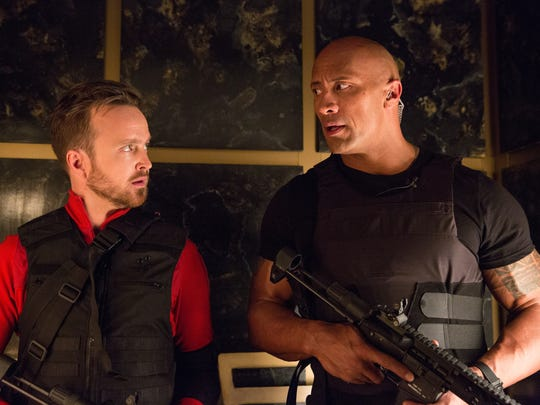 Aaron Paul (left) and Dwayne Johnson are featured in