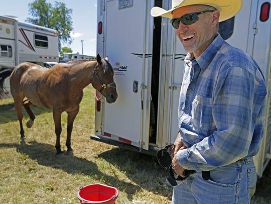 Steer wrestler Dan Morton travels the Midwest rodeo