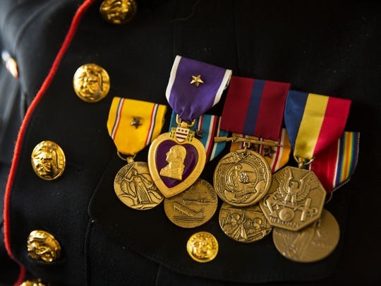Several combat medals, including one of his Purple Hearts, adorn retired Marine Cpl. Edwin Glasberg's uniform. Glasberg was wounded twice during his tours, once when a machine gun bullet grazed his face and when a Japanese soldier stabbed him in the leg with a bayonet.