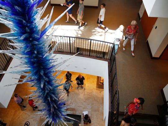 Patrons wander through the Baker Museum and past the