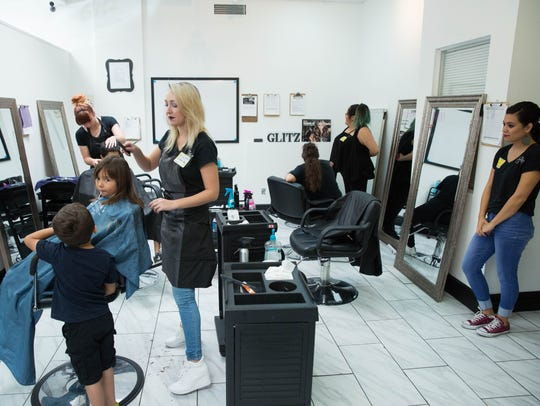 Glitz School of Cosmetology offered free haircuts for