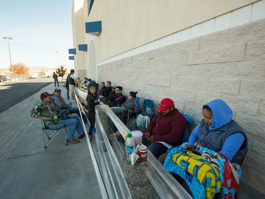 Customers waited around the Best Buy Building Thursday
