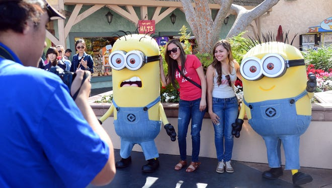 Fans pose with the Minions at the 'Despicable Me' Minion Mayhem attraction at Universal Studios Hollywood.