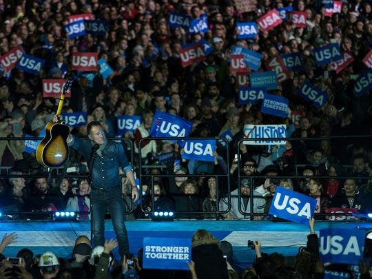 Singer Bruce Springsteen performs during a rally for Democratic presidential nominee Hillary Clinton, former US President Clinton, and US President Barack Obama on Independence Mall, November 7, 2016 in Philadelphia, Pennsylvania.