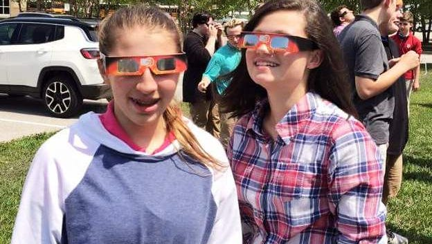 Eclipse New Tech freshmen Sophia Williams and Emma Robinson stepped outside to check out the Eclipse this past Monday.