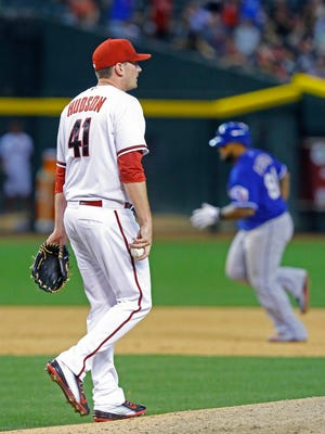 Arizona Diamondbacks starting pitcher Daniel Hudson (41) reacts after giving up a two-run home run to Texas Rangers' Prince Fielder (84)  in the 8th inning of their  MLB game Tuesday, April 21, 2015  in Phoenix, Ariz.