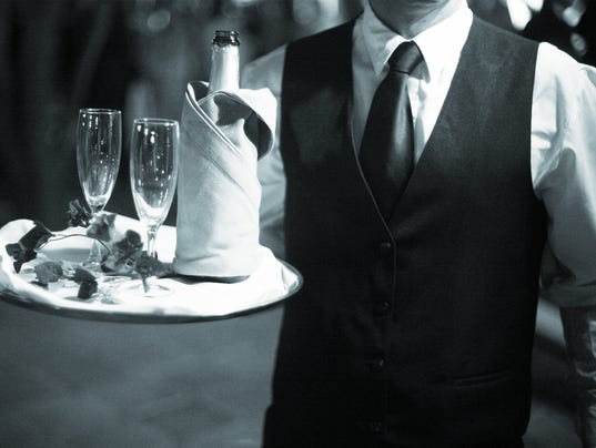 Wedding reception waiter with champagne glasses