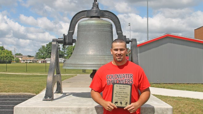 Coldwater's Dylan Targgart, shown here posing by the victory bell with his The Daily Reporter Male Athlete of the Year award, was recently awarded the Gatorade Michigan Boys Track and Field Athlete of the Year award.