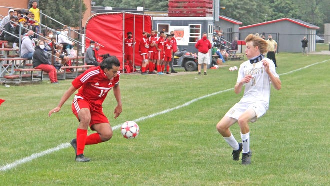 Coldwater's Mo Nasser (12) deaks a Hackett defender on his way to the goal Tuesday night. Nasser had a goal and an assist in the win.