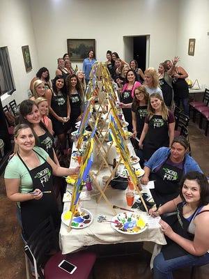 Uncorked Art allows customers to sip on local wine from the Balzano Family Vineyard, while they are instructed how to paint a photo.