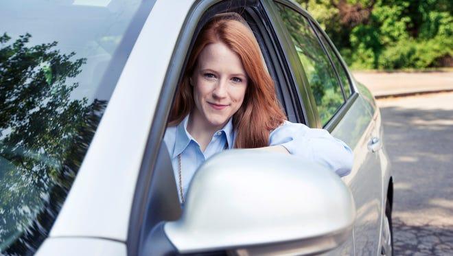 Teenage girl with car.