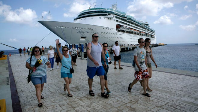 Passengers disembark Royal Caribbean's Enchantment of the Seas during a port call in Cozumel.