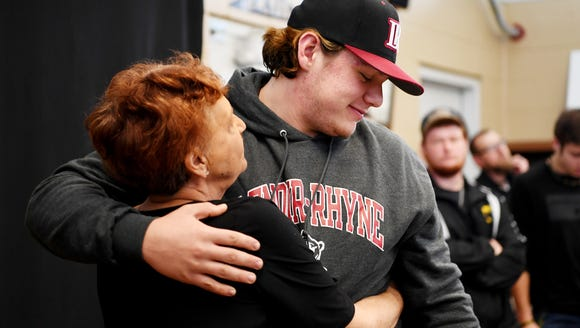 Cameron Parker receives a hug from his grandmother,