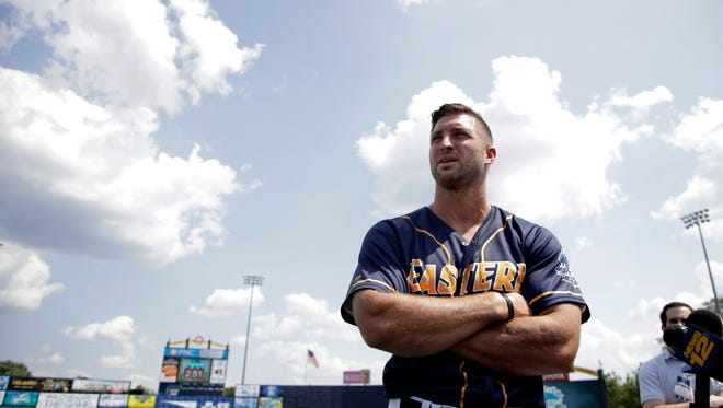 Tim Tebow talks to reporters during a news conference prior to the Eastern League All-Star Game.
