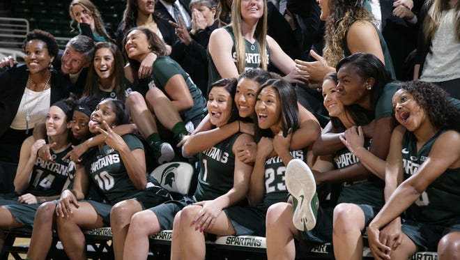 The Michigan State women's basketball team clowns around for a team photo during media day Thursday, Oct. 30, 2014, in East Lansing, Mich.