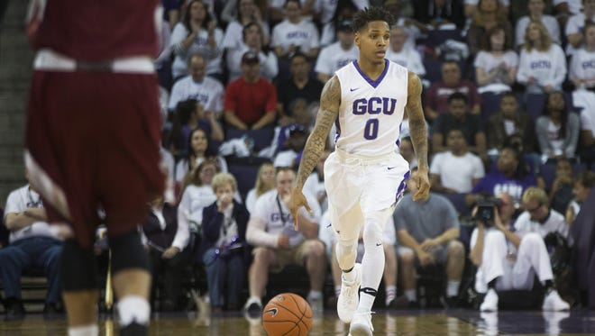 GCU's DeWayne Russell (0) dribbles down court against New Mexico State at GCU Arena on February 11, 2017 in Phoenix, Ariz.