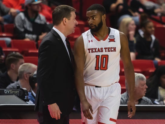 Texas Tech head coach Chris Beard talks with guard