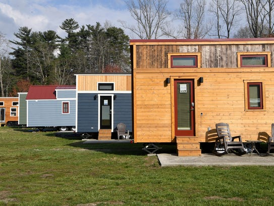 A section of smaller, portable tiny homes sit in a