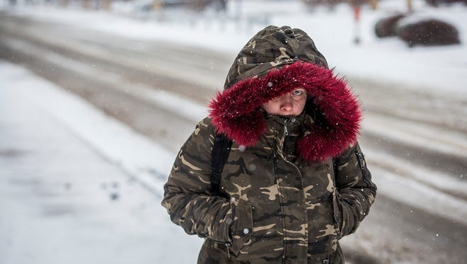 Teneka Cooper braves the cold on Adams Street in downtown Muncie in this file photo from the winter of 2017-18.