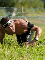 Greencastle's Corey Ramyo maneuvers under barbed wire as part of a demonstration. Ramyo is a certified Spartan SGX coach and owner of No Time to Lose Fitness LLC in Greencastle. He also is part of Team LIttle Giants, one of teams participating in the Spartan Ultimate Team Challenge Season 2 to begin airing on NBC Monday.