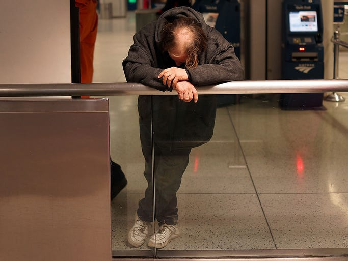 A homeless person rests on Jan. 28 at Penn Station in New York City. Three thousand volunteers canvassed parks, subways, bus stations and other public places during the annual Homeless Outreach Population Estimate project.