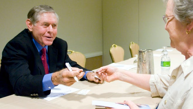 """Cliff Richey (left) chats with Ann Wilkerson of Montgomery City, Mo., after discussing his new book, """"Acing Depression: A Tennis Champion's Toughest Match,"""" during the 2010 National Alliance on Mental Illness Convention in Washington."""