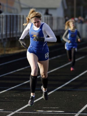 Sheboygan North's Bailey Harrington pushes near the finish line during the 400-meter event on Monday.