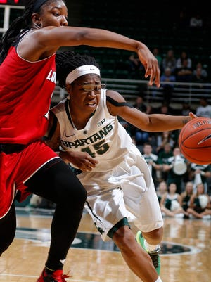 Michigan State's Akyah Taylor, right, drives against Louisville's Myisha Hines-Allen Thursday, Dec. 3, 2015, in East Lansing, Mich. Michigan State fell 85-78.