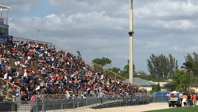 Cape Coral High School students gather in the football stadium stands after walking out of class Wednesday, Feb. 21, 2018 in support of the victims of the Parkland shooting.