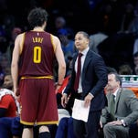 Cleveland Cavaliers forward Kevin Love (0) talks with head coach Tyronn Lue during a recent game.