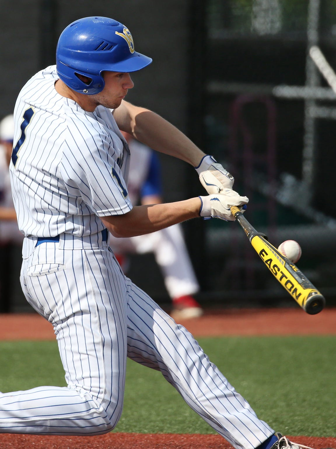 Schroeder's Shane Marshall rips an RBI single to start