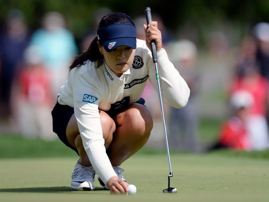 In Gee Chun of South Korea places her ball as she prepares to putt on the sixth green during the third round of the Canadian Pacific Women's Open golf tournament in Ottawa, Ontario, Saturday, Aug. 26, 2017. (Adrian Wyld/The Canadian Press via AP)