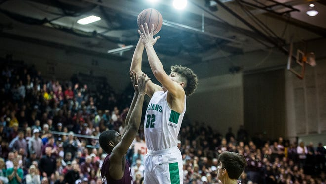 New Castle's Mason Gillis shoots against Culver at Lafyette-Jeff High School in their semi-state game Saturday, March 17, 2018. Culver defeated New Castle 65-60.