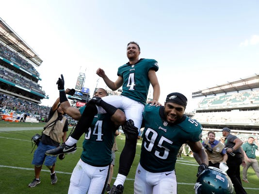 Philadelphia Eagles' Jake Elliott is carried off the field after kicking the game-winning field goal during an NFL football game against the New York Giants, Sunday, Sept. 24, 2017, in Philadelphia. Philadelphia won 27-24. (AP Photo/Michael Perez)