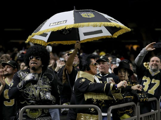 New Orleans Saints fans cheer in the NFC Championship game between the Los Angeles Rams and the New Orleans Saints at the Mercedes-Benz Superdome