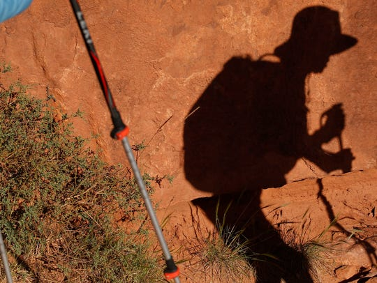 Gabriela Orpinel uses his trekking poles to make his