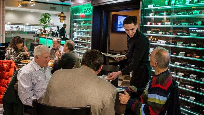 Customers dine at Vincenza & Margherita Italian-American Bistro in Wilmington on Wednesday.
