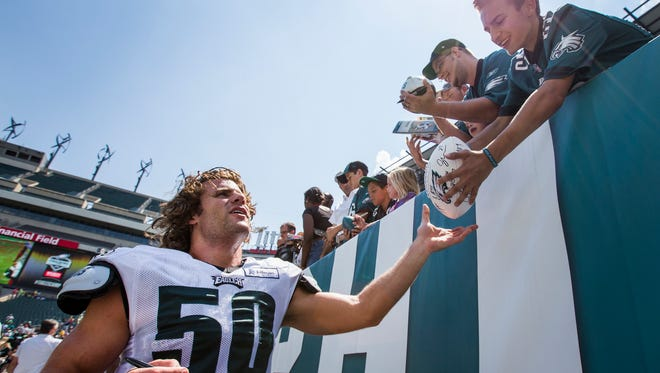 Eagles linebacker Kiko Alonso signs autographs for fans following practices at Lincoln Financial Field during training camp on Tuesday afternoon.