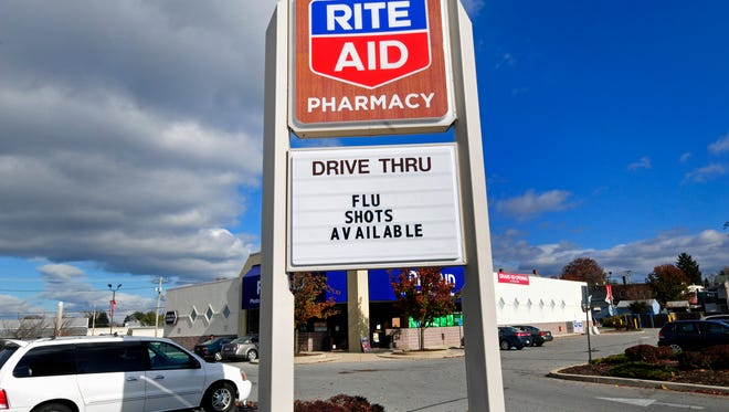 Rite Aid, photographed Wednesday, Nov. 11, 2105 at Queen and Fourth streets, may merge with Walgreens under a new deal.